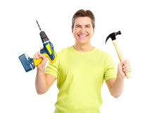 Man with hammer and drill. Handsome man with cordless drill and hammer.  Isolated over white background Stock Photography