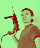 Man with hammer drill in hands. Royalty Free Stock Images
