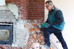 Man with hammer drill Royalty Free Stock Photography