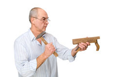 A man with a hammer and a plane Stock Images