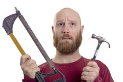 Man with hammer and saw Stock Images