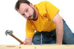 Man Hammering In Nail Royalty Free Stock Photography