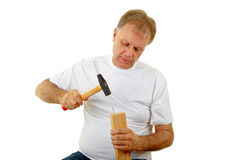 Man hammering nail Stock Images