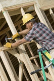 Man Hammering Nail On Wooden Formwork Stock Photography