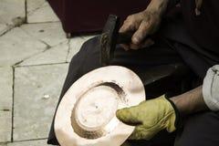 Man hammering tinplate Royalty Free Stock Photos