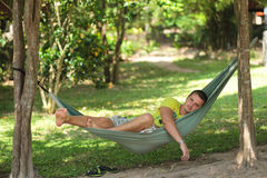 Man in a hammock Stock Image