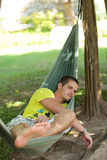 Man in a hammock Royalty Free Stock Images
