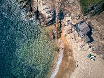 Man in hammock on a beach aerial view royalty free stock image