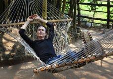 The man in a hammock royalty free stock photos