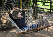 The man in a hammock Royalty Free Stock Photography