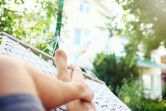Man in a hammock on a summer day Stock Photography
