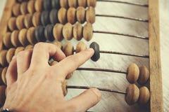 Man hand abacus stock image