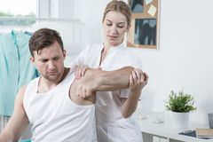 Man with hand ache exercising Royalty Free Stock Photo
