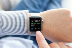 Man hand with Apple Watch in the home Stock Photo