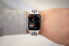 Man hand with Apple Watch Series 4 with Heart Rate. Alushta, Russia - November 6, 2018: Man hand with Apple Watch Series 4 with Heart Rate on the screen. Apple royalty free stock photo
