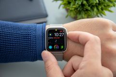 Man hand with Apple Watch Series 4 over the table stock photo