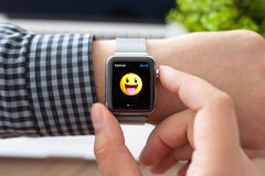 Man hand with Apple Watch and smile on a screen Stock Image