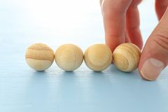 Man hand arranging wooden beads. mock up or template. Man hand arranging wooden beads. mock up or template royalty free stock images