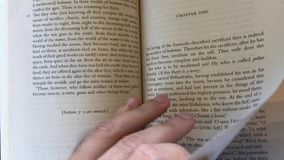 Man hand book flipping 4k stock video