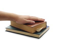 Man hand on the brown and green books. Stock Photography