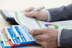 Man hand with business report Stock Photography