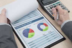 Man hand with business report Stock Images