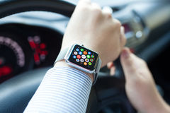 Man hand in the car with Apple Watch and Icon Stock Photo