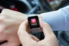 Man hand in the car watch and app auto play Royalty Free Stock Images