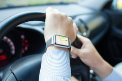 Man hand in the car with watch app navigation Royalty Free Stock Images