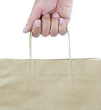 Man hand carries shopping bag . Royalty Free Stock Photos