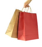 Man hand carries shopping bags Royalty Free Stock Image
