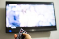 Man hand changing channels on the TV. Man hand changing channels on the modern TV royalty free stock photos