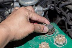 Man hand is checking battery of car Stock Photography