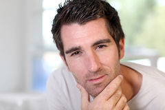 Man with hand on chin Royalty Free Stock Photography