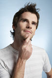 Man With Hand On Chin Looking Up Stock Photo