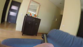 Man hand clean couch in living room with vacuum cleaner. 4K stock video footage
