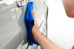 A man hand cleaning car Royalty Free Stock Photos
