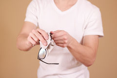Man hand cleaning glasses lens with isolated background Stock Image