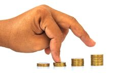 Man hand with coin for banking saving investment economy finance Stock Images