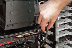 Man hand Connecting The Power Supply To The Graphics Card. Stock Photos