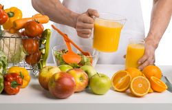 Man hand cook cooking cfreshly squeezed juice on kitchen Stock Images