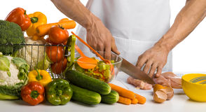 Man hand cook cut chicken meat  chicken breast and salad on ki Stock Photography