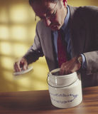 Man with hand in cookie jar_1 Royalty Free Stock Images