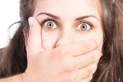Man hand covering the mouth of a scared girl Royalty Free Stock Image