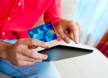 Man hand credit card and tablet Stock Images