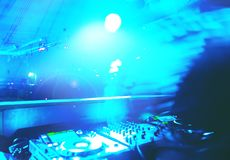 Man hand disc jockey mixing and blending music tracks. Soft view of man hand disc jockey mixing and blending music tracks on his deck in the darkness of a party royalty free stock photo