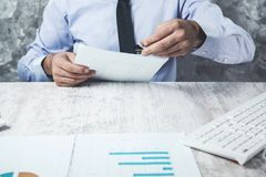 Man hand on document in office stock photo