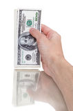 Man hand with 100 dollar bills isolated on a white background Stock Photo