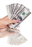 Man hand with 100 dollar bills isolated on a white background Stock Photography