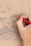 Man hand draw picture with landscape Royalty Free Stock Photo